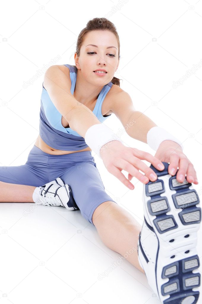 Physical stretching of young sporting attractive girl - isolated — Stok fotoğraf #1463801