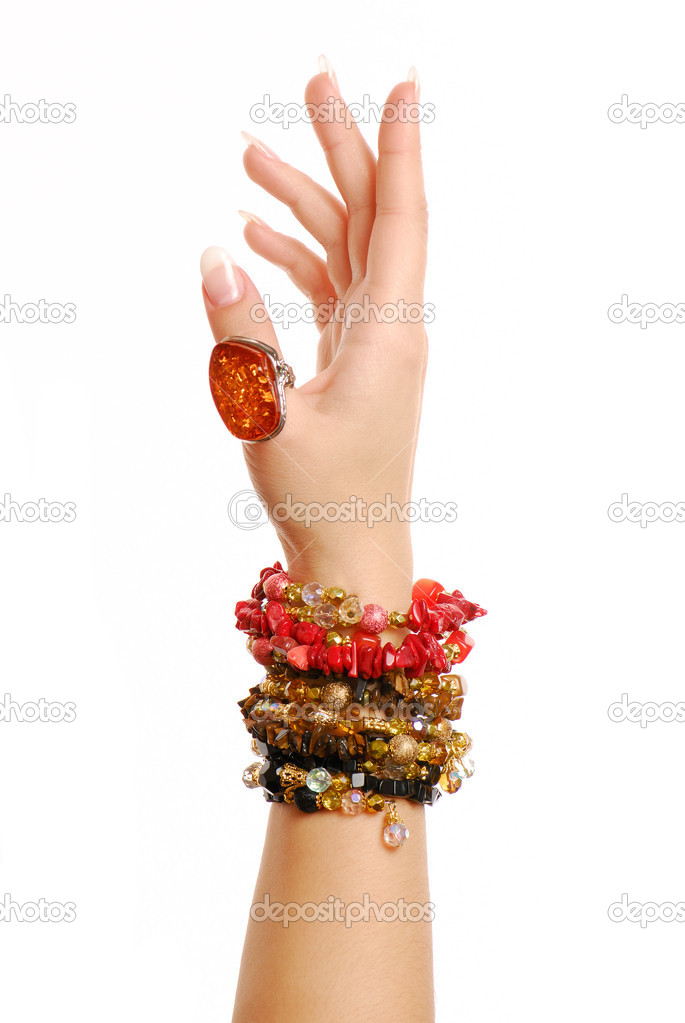 Many objects of jewelry on female hands. — Stock Photo #1468777