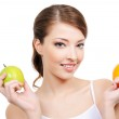 Beautiful young woman with fruits — Stock Photo