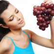 Woman holding a bunch of grapes — Stock Photo #1477499