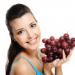 Woman with bunch of grapes — Stock Photo #1477538