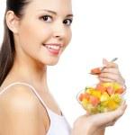 Girl eating fruit citrous dessert — Stock Photo