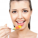 Beauty girl eating fruits — Stock Photo #1477639
