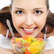 Happy female with fruits — Stock Photo #1477685
