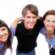 Three teenagers holding heads - Stock Photo