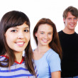 Three young smiling teens — Stock Photo