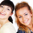 Two smiling  girlfriends - Stock Photo