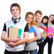 Group of  young  smiling students - Stock Photo