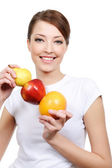 Woman holding some fruits — Stock Photo