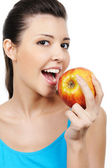 Taste red apple — Stock Photo