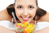 Happy female with fruits — Stock Photo