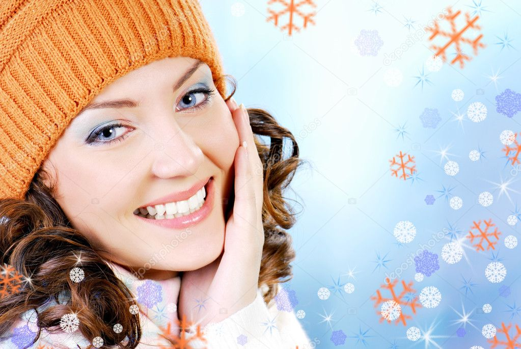 Cheerful woman face clothing in warm orange hat. Winter season. — Stock Photo #1476724