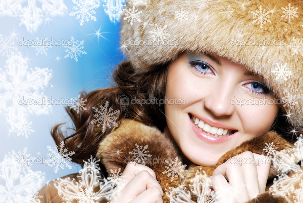 CLose-up beautiful face of young woman in fur hat  Stock Photo #1476765
