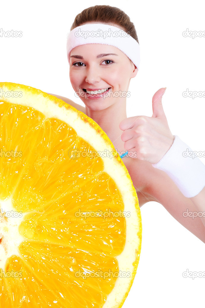 Smiling young girl in healthy lifestyle concept with big orange — Stock Photo #1476935