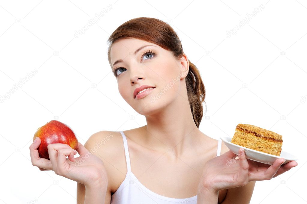 Beautiful thoughtful woman with food in her hands — Stock Photo #1476966