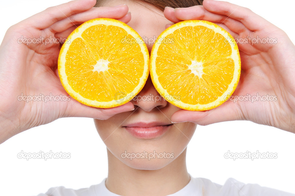 Female face with fresh section orange instead of her eyes  Stock Photo #1477127