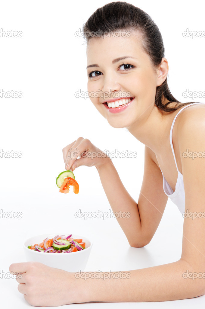 Young laughing woman eating healthy salad   Stock Photo #1477676