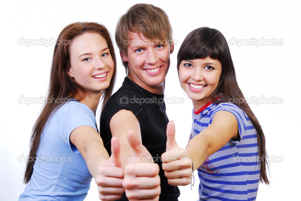 Three young teenagers laughing and giving the thumbs-up sign. — Stock Photo #1478023