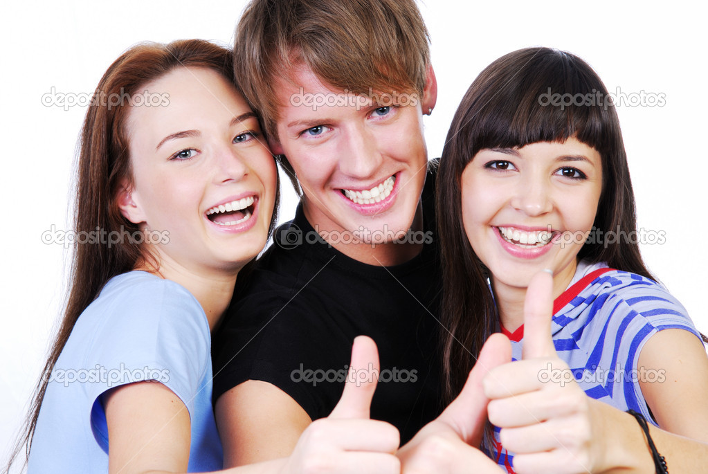 Portrait of a three young teenagers laughing and giving the thumbs-up sign.  Stock Photo #1478044