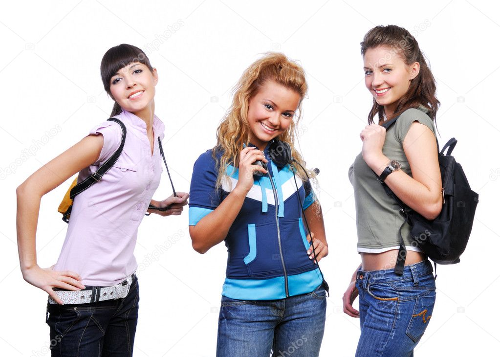 Unity of three fun  girlfriends standing. Studio shot no a white. — Stock Photo #1478239