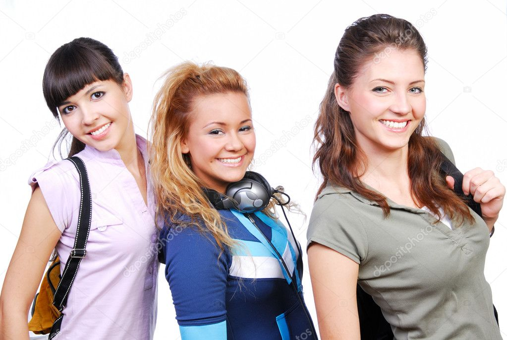Team of three funny  girlfriends standing. Studio shot no the white background. — Stock Photo #1478261