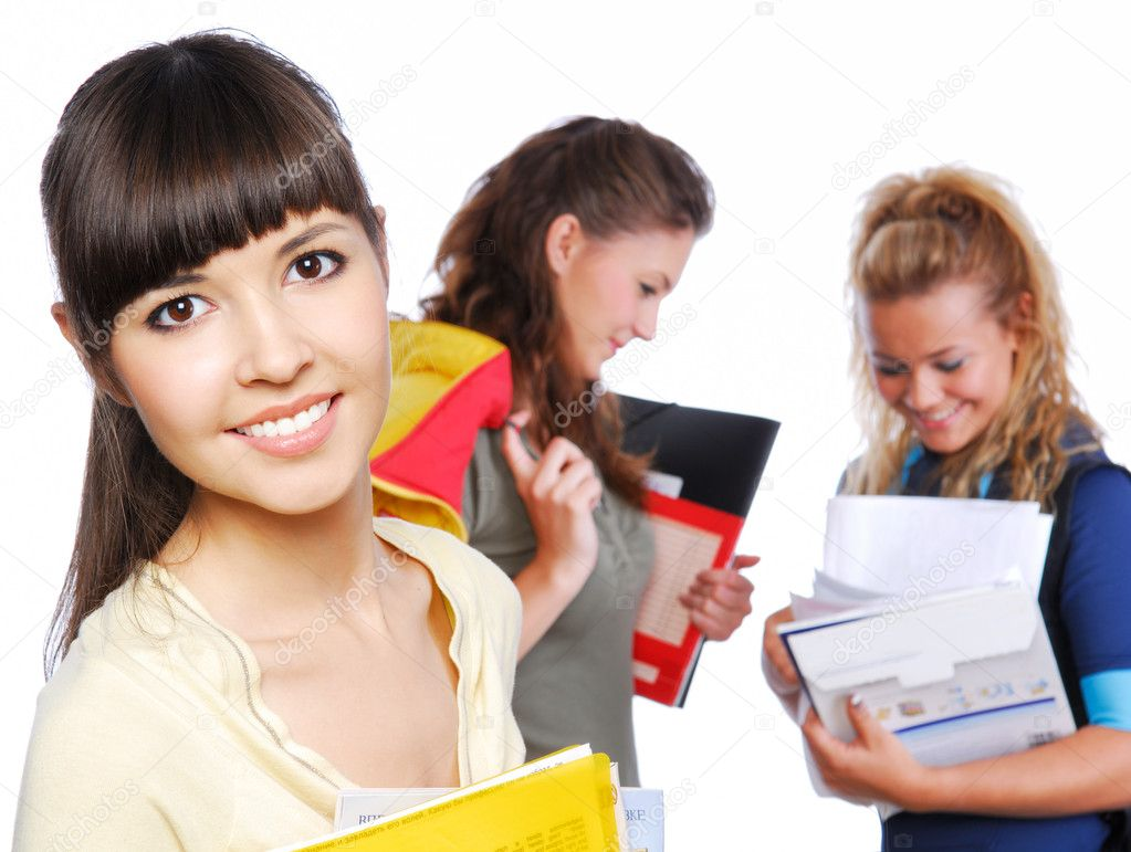 Close-up face of cute female student holding yellow folder in hands - focus on foreground.  — Stock Photo #1478330