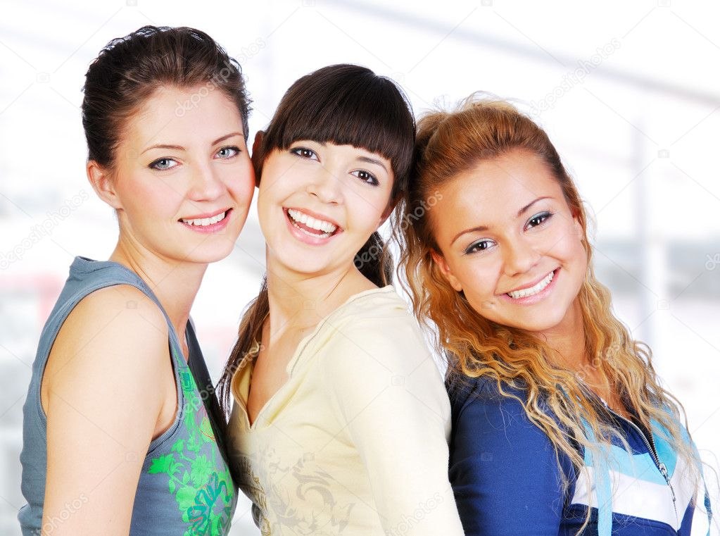 Portrait of three female teenagers friends on white background  Stock Photo #1478466