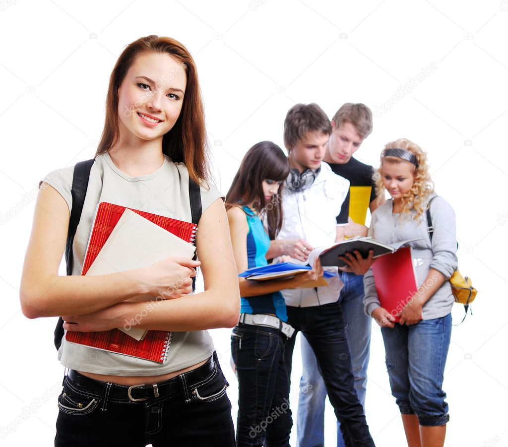 Graceful female student with books in hands looking at camera. On a background classmates — Stok fotoğraf #1478614