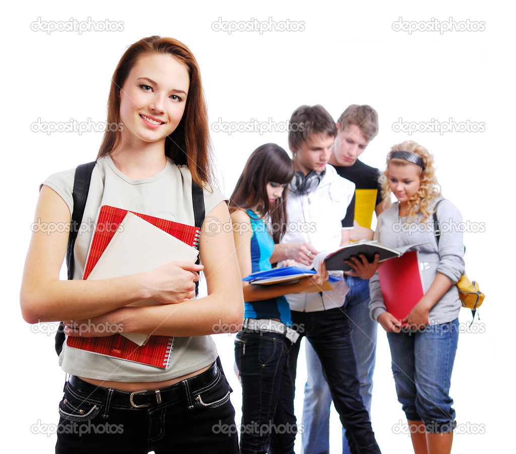 Graceful female student with books in hands looking at camera. On a background classmates — Photo #1478614