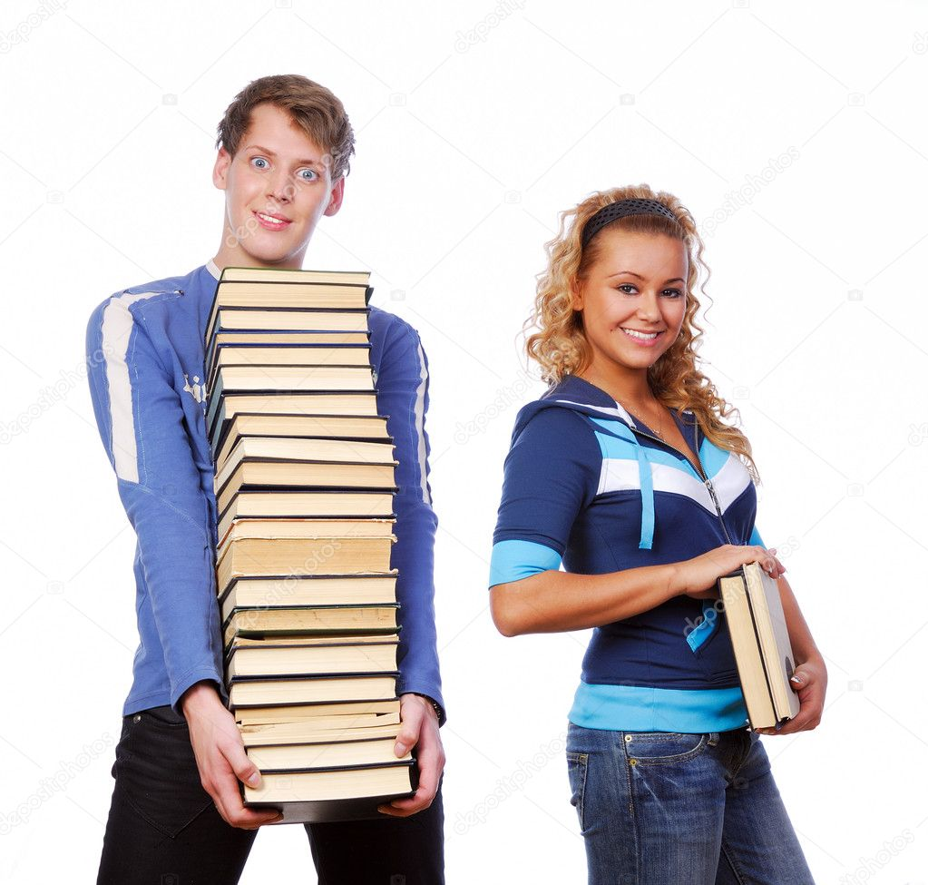 Two funny students holding the heap of books — Stock Photo #1478714