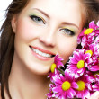 Woman portrait with flowers — Stock Photo