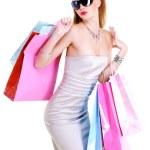 Stylishly dressed girl purchases — Stock Photo #1488137