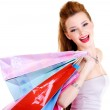 Happy laughing girl with purchases — Stock Photo