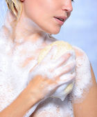 Woman pampering her body — Stock Photo