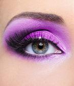 Purple make-up of woman eye — Stock Photo