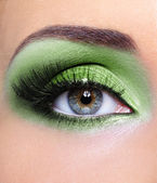 Green make-up of woman eye — Photo
