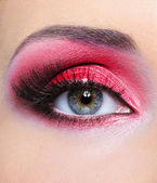 Make-up of woman eye with red eyeshadow — Stock Photo