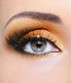 Woman eye with orange make-up — Stock Photo
