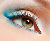 Green eye with blue eyeshadows — Stock Photo