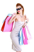 Stylishly dressed girl purchases — Stock Photo