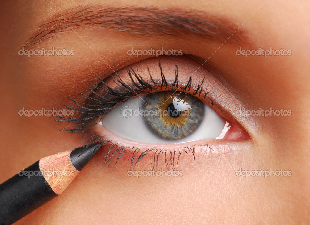Black cosmetic pencil. Beautiful  women eye close-up.  Stock Photo #1484703