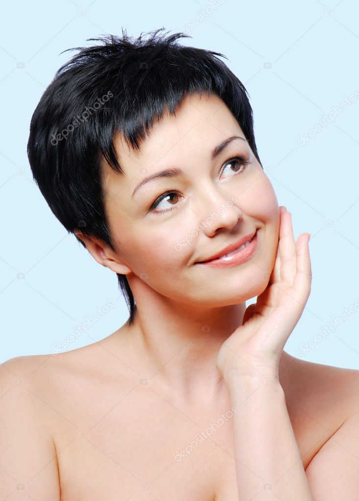 Woman with healthy condition of skin on a blue background — Stock Photo #1485052