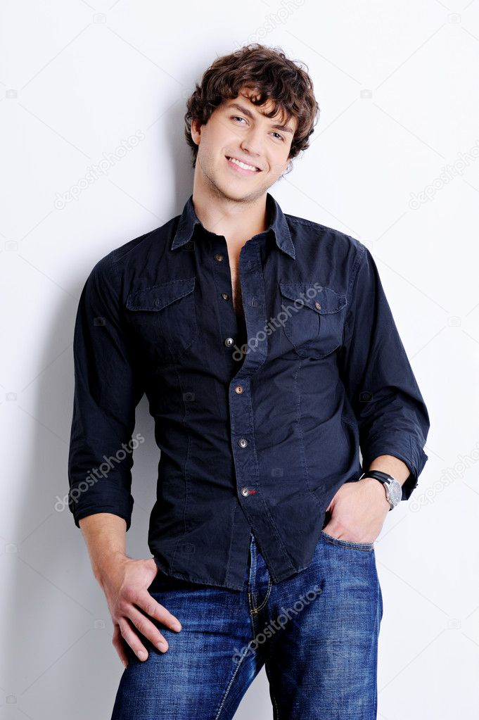 Portrait of a happy handsome young man posing in  studio with beautiful curly hairs — Foto de Stock   #1485757