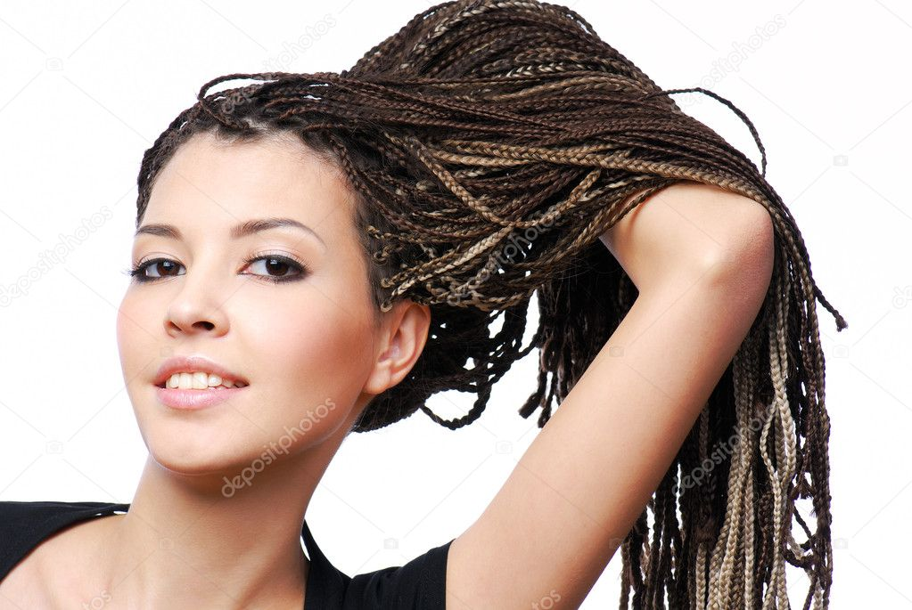 Portrait of young pretty girl showing the  dreadlocks - on white background — Stock Photo #1486005