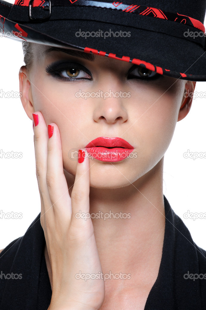 Close-up face of beautiful woman with bright red lips and fingernails in the fashion hat  Stock Photo #1487615