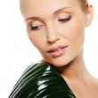Beautiful woman with green leaf — Stock Photo