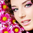 Beutiful woman with pink flowers — Stock Photo