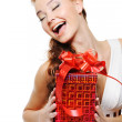 Woman holding the red gift box — Stock Photo