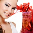 Sexy woman face with a christmas gift - Stock Photo