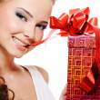 Sexy woman face with a christmas gift — Stok fotoğraf